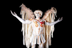 Valentine's Day, cupid man with harp. Body painting with hearts. White angel with big wings Royalty Free Stock Photos
