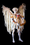 Valentine's Day, cupid man with harp. Body painting with hearts. White angel with big wings Stock Photos