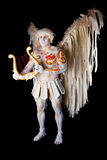 Valentine's Day, cupid man with harp. Body painting with hearts. White angel with big wings Royalty Free Stock Photography
