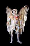 Valentine's Day, cupid man with harp. Body painting with hearts. White angel with big wings Stock Photo