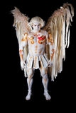 Valentine's Day, cupid man with harp. Body painting with hearts. White angel with big wings Royalty Free Stock Image