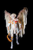 Valentine's Day, cupid man with harp. Body painting with hearts. White angel with big wings Stock Photography