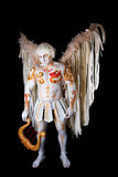 Valentine's Day, cupid man with harp. Body painting with hearts. White angel with big wings Royalty Free Stock Images