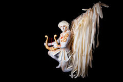Valentine's Day, cupid man with harp. Body painting with hearts. White angel playing the harp Stock Images
