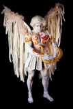 Valentine's Day, cupid man with harp. Body painting with hearts. White angel playing the harp Stock Photography