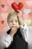 Valentine's Day - cute child with red Heart in hands. Stock Photography