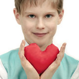 Valentine's Day - cute child with red Heart in hands. Royalty Free Stock Photo
