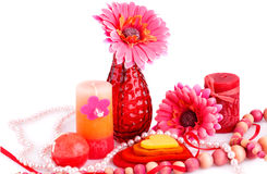 Valentine's day. Daisy flower in the vase, candles, necklaces and colorful hearts on white background Stock Image