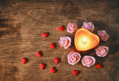 Valentine`s day, dark background candle heart, confetti, pink ro Stock Photos