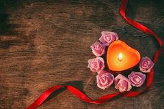 Valentine`s day, dark background candle heart, pink roses Stock Image
