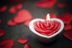 Valentine`s day, dark background candle heart. Valentine`s day, dark background candle heart on wooden table royalty free stock photos