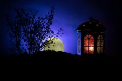 Valentine`s day decor concept. Romantic scene. Big Lantern as lovers house with rising moon on night decor background. Selective f. Valentine`s day decor concept stock photo
