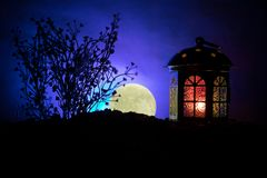 Valentine`s day decor concept. Romantic scene. Big Lantern as lovers house with rising moon on night decor background. Selective f. Valentine`s day decor concept royalty free stock photography