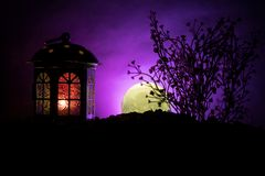 Valentine`s day decor concept. Romantic scene. Big Lantern as lovers house with rising moon on night decor background. Selective f. Valentine`s day decor concept stock photography