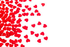 Valentine`s day decorative border of red hearts confetti isolated on white background. stock photography
