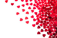Valentine`s day decorative border of red hearts confetti isolated on white background. royalty free stock photography