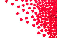 Valentine`s day decorative border of red hearts confetti isolated on white background. stock image