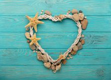 Valentine`s Day. Decorative heart in a marine style from seashel Stock Images
