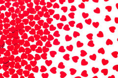 Valentine`s day decorative pattern red hearts confetti isolated on white background. Stock Photo