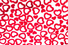 Valentine`s day decorative pattern red hearts confetti isolated on white background. royalty free stock photo