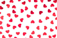 Valentine`s day decorative pattern red hearts confetti isolated on white background. stock photography