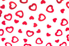 Valentine`s day decorative pattern red hearts confetti isolated on white background. stock photos