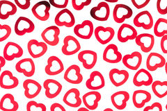 Valentine`s day decorative pattern red hearts confetti isolated on white background. royalty free stock images