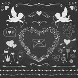 Valentine's day decorative vector set. Valentine's Day symbols on a chalkboard: cupids, hearts, candies, arrows, and other cute stuff Royalty Free Stock Photos