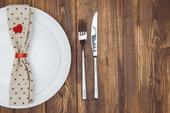 Valentine's day dinner setting, Knife, fork, napkin and plate Royalty Free Stock Images