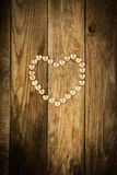 Valentine`s day. Нeart from buttons on a wooden background Royalty Free Stock Photography