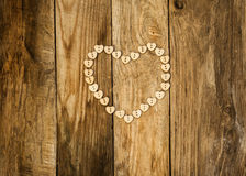 Valentine`s day. Нeart from buttons on a wooden background Royalty Free Stock Images