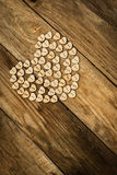 Valentine`s day. Нeart from buttons on a wooden background Stock Image
