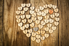 Valentine`s day. Нeart from buttons on a wooden background Royalty Free Stock Image
