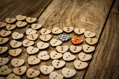 Valentine`s day. Нeart from buttons on a wooden background.  Close-up Royalty Free Stock Photography