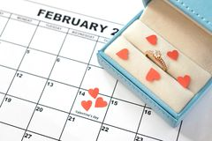 Valentine`s day, February 14. wedding ring in blue box. Offer to marry royalty free stock images
