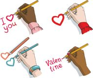 Valentine's Day.female hands with crayons an Royalty Free Stock Photos