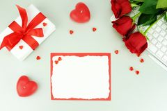 Valentine`s day. Festive background with red roses,. Gift and card for text. top view. copy space Royalty Free Stock Images