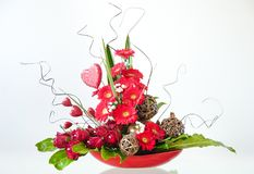 Valentine`s Day Flower Arrangement. With red hearts, roses and gerberas Royalty Free Stock Image