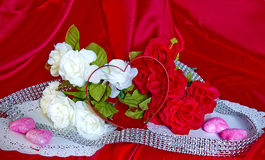 Valentine's Day Flowers,Candy,Heart Shape on Red Silk Royalty Free Stock Photography