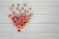 Valentine`s day. Flowers and love letter on wooden background. Retro style. Valentine`s day. Flowers and letter. wooden background Stock Photos