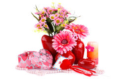 Valentine's day. Flowers in vases, red heart glass, necklace, gift boxes and candle isolated on white background Royalty Free Stock Image