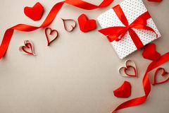 Valentine`s Day. Frame made of gift, origami hearts and ribbon on gray background. Valentines day background. Flat lay, top view,. Copy space stock photos