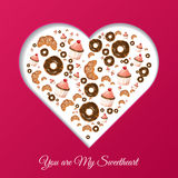 Valentine`s Day frame for your text. Sweets in the form of heart. Muffin, croissant, donut. Stock Images