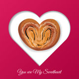 Valentine`s Day frame for your text. Sweets in the form of heart. Royalty Free Stock Photo
