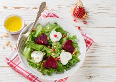 Valentine`s day. Fresh salad with goat cheese, roasted beets and lettuce. Royalty Free Stock Photo