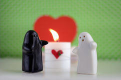 Valentine´s Day Ghosts Wedding with Candle, Flowers and Hearth Royalty Free Stock Images