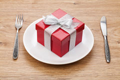 Valentine's day gift box on plate and silverware Stock Images