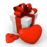 Valentine's Day gift box with red hearts. Gift box with one large and three small hearts Stock Photo
