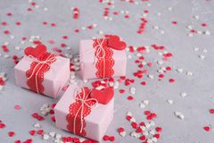 Valentine`s day Gift boxes  with presents and decorations. On gray background with sprinkles Stock Photo