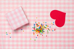 Valentine`s Day with gift, candy and heart on plaid background Stock Photo